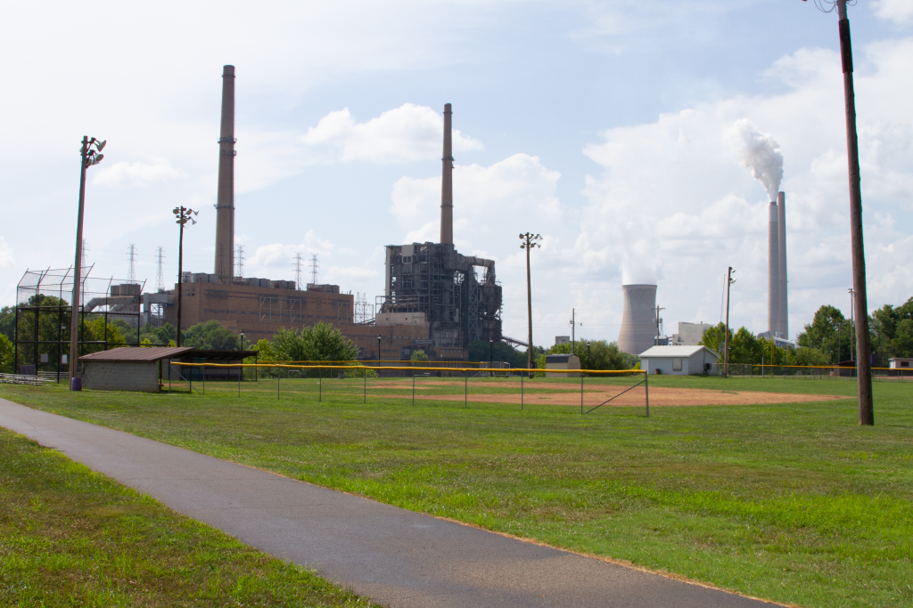 View of closed Philip Sporn power plant and operating Mountaineer power plant from a baseball field near Racine Ohio.